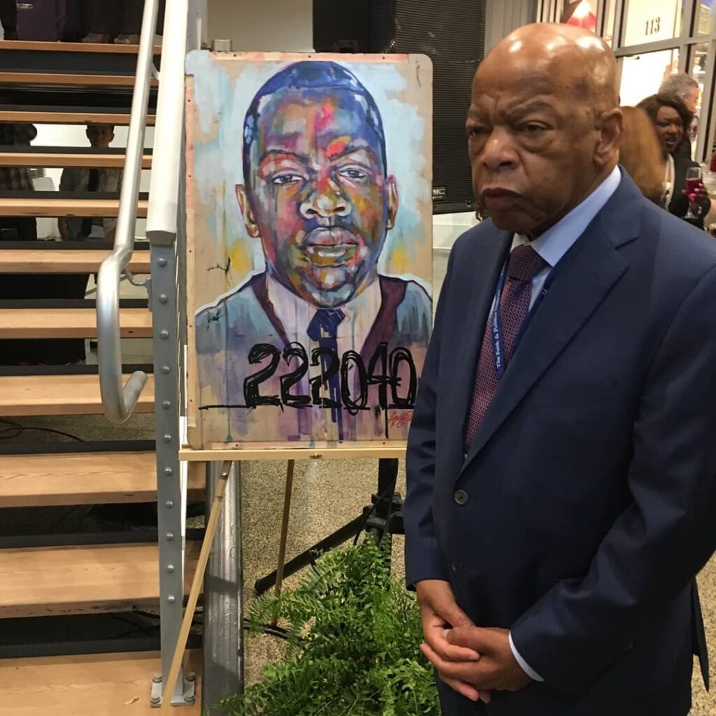 John Lewis Poses With His Portrait Alabama Painters