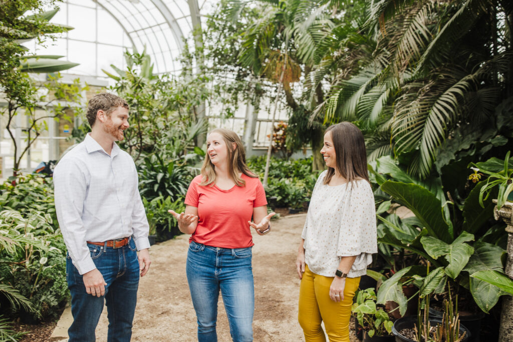 Realtysouth Agents Standing In Greenhouse