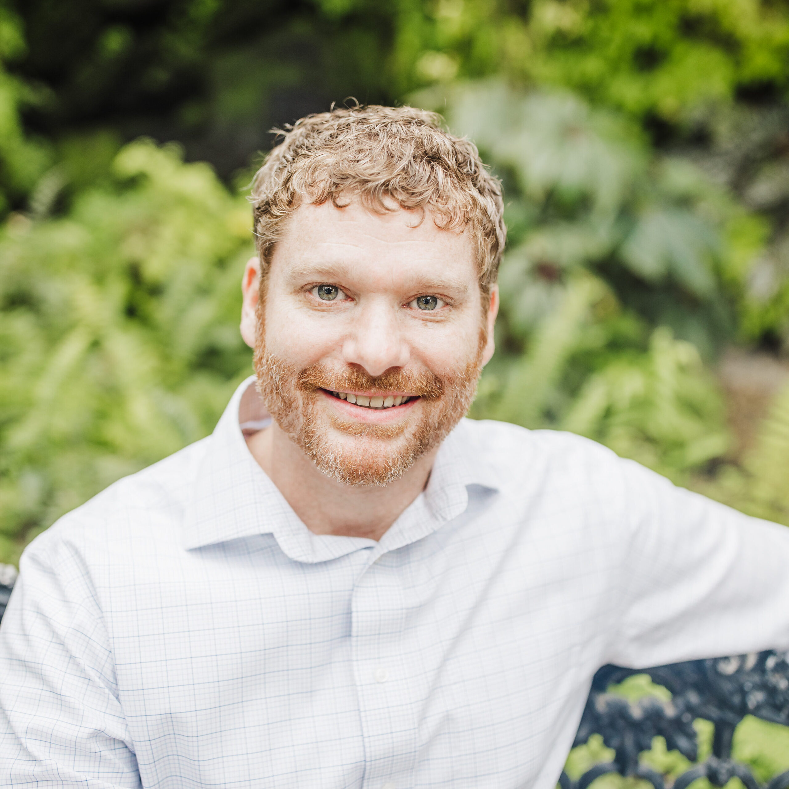 Jason Dailey Sitting In Greenery - Top Realtysouth Agent