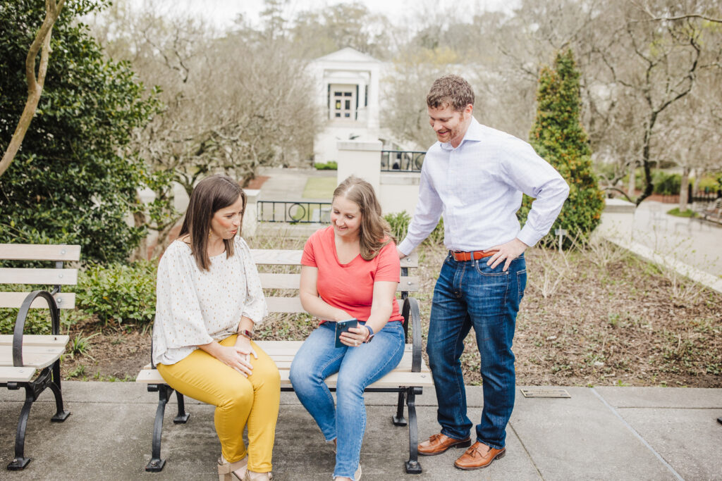 Two Realtysouth Agents Sitting On A Bench