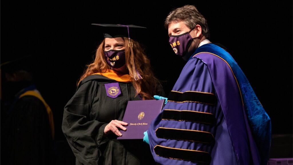 Woman Getting A Diploma At Una